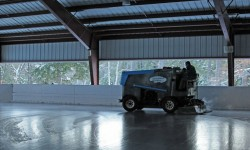 Vintage Zamboni cleaning ice of Tohko Dome skating rink at King Pine and Purity Spring Resort