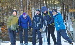 A group ready to snowshoe at Purity Spring Resort