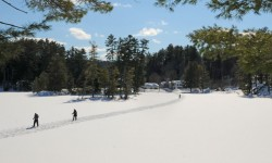 Snowshoers making their way across Purity Lake