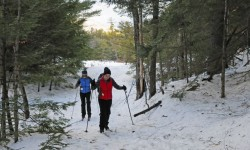 A couple of cross country skiers at Purity Spring Resort