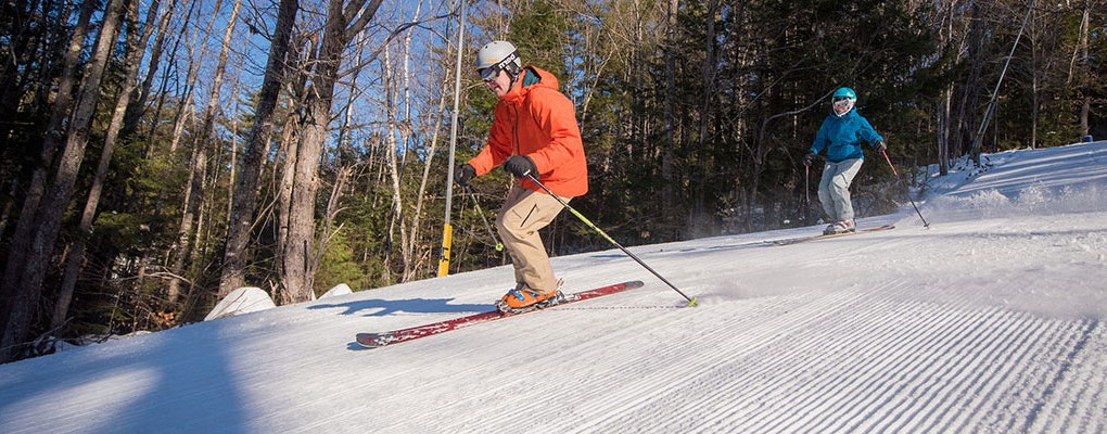 Couple skiing at King Pine