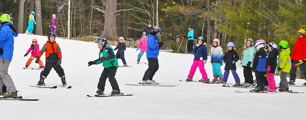 Group skiing at King Pine