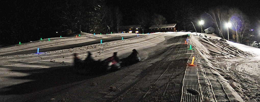 Snowtubing at night at King Pine