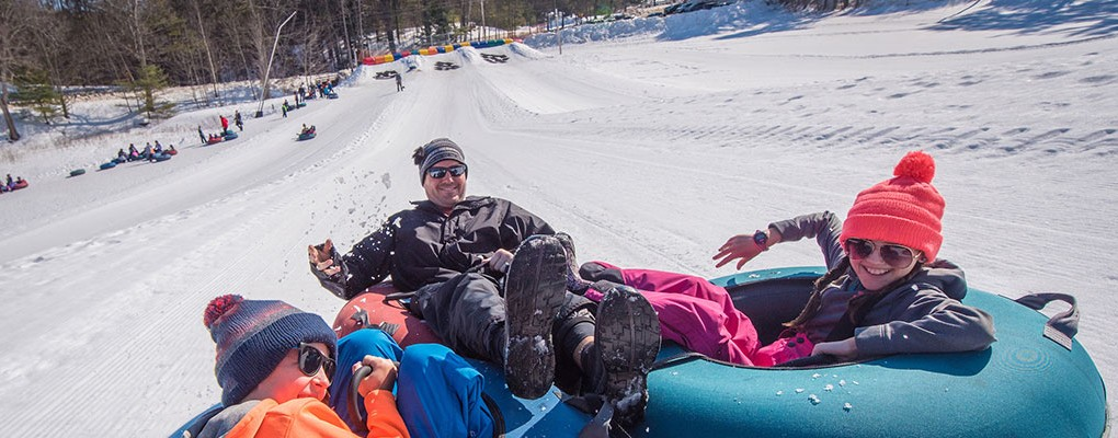 Family snowtubing at King Pine