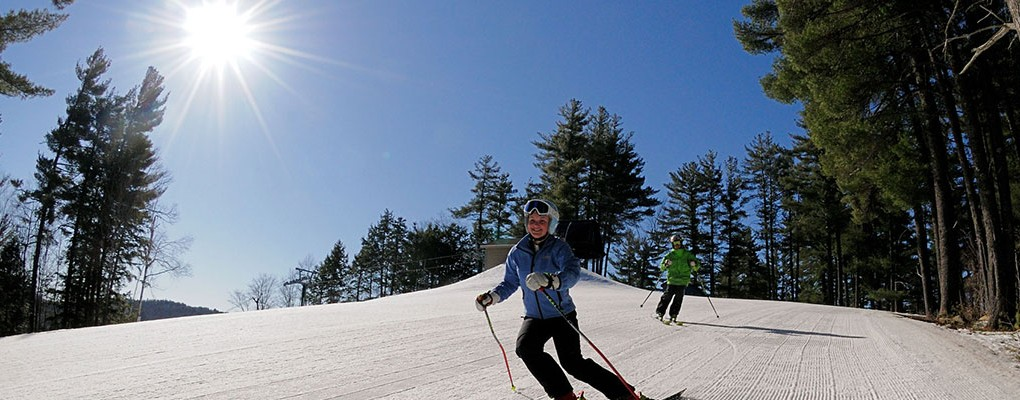 Sunny skiers at King Pine