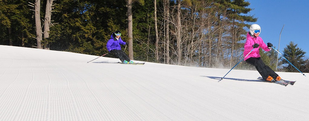 Two Skiers On Fresh Corduroy