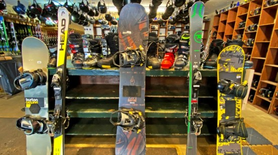 Sample of rental skis and snowboards for sale.